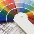 Stock Photo: Color samples for selection with house plon background