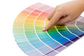 Woman hand pointing to a sample color chart — Stock Photo