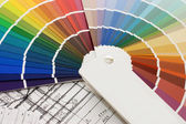 Color samples for selection with house plan on background — Stock Photo