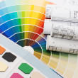Color samples for selection with house plan on background — Stock Photo #4209905