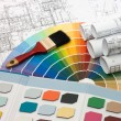 Color samples for selection with house plan on background — Stock Photo #4416529