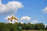 Orthodox church with gold domes — Stock Photo