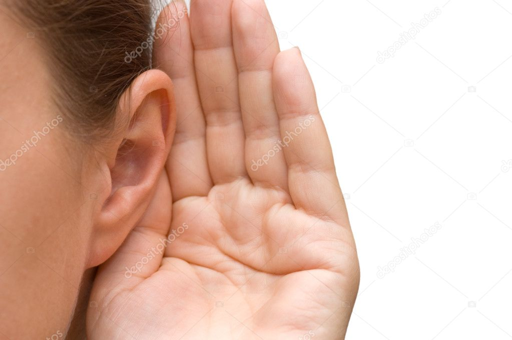 Girl listening with her hand on an ear — Stock Photo #4416313