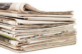 Various newspapers over white background — Stock Photo