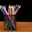 Various colour pencils on a wooden table — Stock Photo #4649996