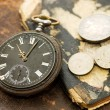 The old book, old watch and money — Stock Photo