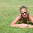 Stock Photo: The young girl lays on a grass
