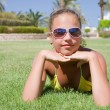 Young girl lays on grass — Stock Photo #4660163