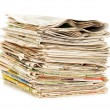Various newspapers over white background - Photo