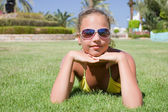 The young girl lays on a grass — Foto Stock