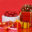 Box with a gift on a red background — Stock Photo