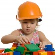 The little girl in a helmet plays — Stock Photo #4748734