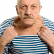 The elderly man in a stripped vest — Stock Photo