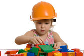 The little girl in a helmet plays — Stock Photo