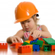 The little girl in a helmet plays — Stock Photo #4808481