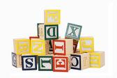 Kostky s písmeny izolovaných na bílém pozadí — Stock fotografie