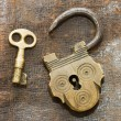 The old lock and key on a leather background — Stock Photo #4914161