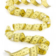 Yellow measuring tape isolated on white background — Stock Photo