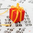 Box with a gift on calendar sheet - - Valentines day — Foto de Stock   #4930006