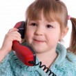 Royalty-Free Stock Photo: The little girl speaks by phone