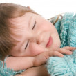 The little girl sleeps on a table - Foto Stock