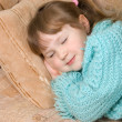 The little girl sleeps on a sofa - 图库照片