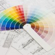 Color samples for selection with house plan on background - Stock Photo
