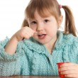 Stock Photo: Little girl eats yoghurt