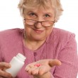 The elderly woman with tablets — Stock Photo
