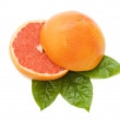 Fresh juicy grapefruits with green leafs. Isolated — Stock Photo