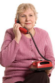 The elderly woman speaks on the phone — Stock Photo