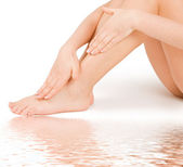 Woman massage feet in water isolated on white background — Стоковое фото