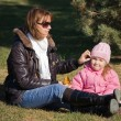 Stock Photo: Mum with a daughter in autumn park