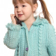 The little girl speaks by phone — Stock Photo