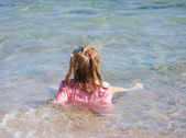 The little girl on seacoast — Stock Photo