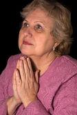 The elderly woman on black background — Stock Photo