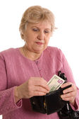 La femme âgée avec un sac à main — Photo