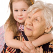 The elderly woman with the grand daughter — Foto Stock