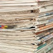 Pile of newspapers close up — Stockfoto