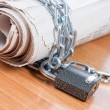 Stock Photo: Newspapers with chains On wooden table