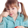 The little girl eats yoghurt — Stock Photo
