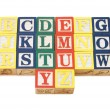 Stock Photo: Cubes with letters isolated on white background