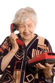 The elderly woman speaks on the phone — Stock Photo