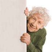 De gamla kvinnan spioner isolerad på vit bakgrund — Stockfoto