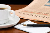 Cup from coffee and the newspaper — Stock Photo