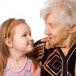 The elderly woman with the grand daughter — Stock Photo