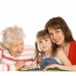 The grandmother with the grand daughter read the book — Stock Photo
