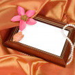 Picture frame with a flower and pearls - Stock Photo