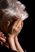 Sad Old Women with her hands to her face is dismay — Stock Photo