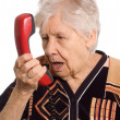 The elderly woman speaks on the phone — Stock Photo #5335645